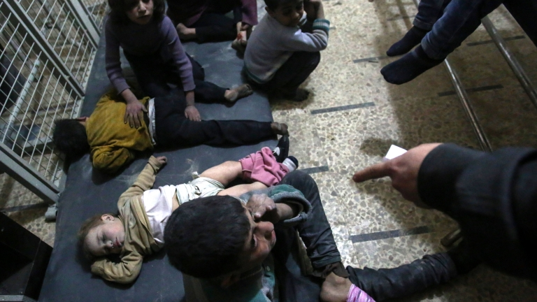 epa05888131 Injured children wait to receive treatment in a field hospital after airstrikes by forces allegedly loyal to the Syrian government, rebel-held Douma, Syria, 04 April 2017. More than 30 people got injured and one got killed. EPA/MOHAMMED BADRA